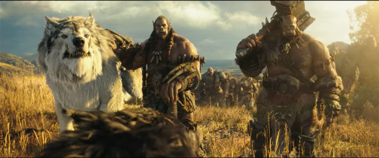 Two orcs and a giant wolf