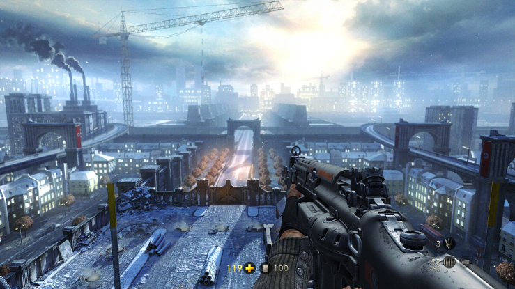 A screenshot of Wolfenstein: The New Order. It depicts a man with a machine gun looking over London as rebuilt by a future Nazi regime.