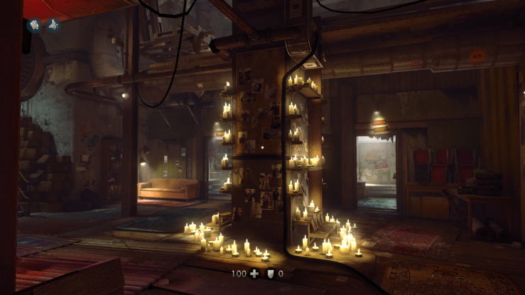Another screenshot from Wolfenstein: The New Order. A shrine to the fallen, surrounded by candles and pictures, within a resistance