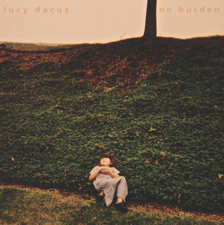 "The cover of Lucy Dacus's album ""No Burden."" It depicts a grassy hill, with a young girl"