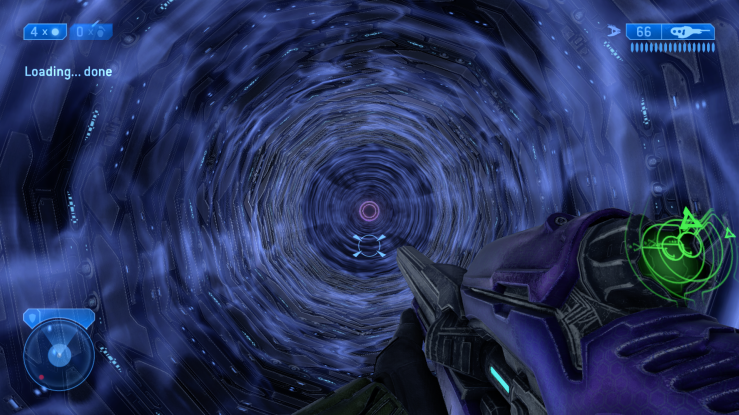 A first person perspection in the game. The player holds an alien riftle and looks into the shaft of an elevator. Blue